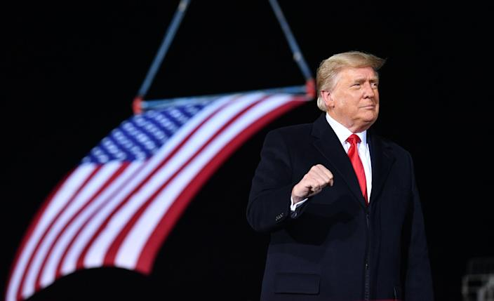 <p>Donald Trump used a campaign rally in Georgia for two GOP Senate candidates to threaten his VP and GOP lawmakers to reject the Electoral College result.</p> (AFP via Getty Images)
