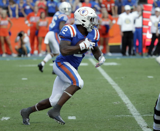 Florida running back Lamical Perine takes off on an 88-yard touchdown run against Auburn during the second half of an NCAA college football game, Saturday, Oct. 5, 2019, in Gainesville, Fla. (AP Photo/John Raoux)