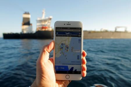The position of the Iranian oil tanker Adrian Darya 1, formerly named Grace 1, is seen on a mobile phone as it sits anchored after the Supreme Court of the British territory lifted its detention order, in the Strait of Gibraltar