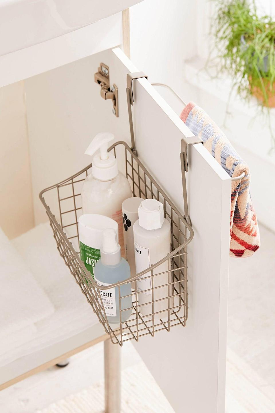 "<p>Your cabinets will feel so organized with this <a href=""https://www.popsugar.com/buy/Grid-Over--Cabinet-Basket-432638?p_name=Grid%20Over-the-Cabinet%20Basket&retailer=urbanoutfitters.com&pid=432638&price=18&evar1=moms%3Aus&evar9=46083939&evar98=https%3A%2F%2Fwww.popsugar.com%2Ffamily%2Fphoto-gallery%2F46083939%2Fimage%2F46083958%2FGrid-Over--Cabinet-Basket&list1=shopping%2Corganization%2Cbathrooms%2Chome%20organization&prop13=mobile&pdata=1"" class=""link rapid-noclick-resp"" rel=""nofollow noopener"" target=""_blank"" data-ylk=""slk:Grid Over-the-Cabinet Basket"">Grid Over-the-Cabinet Basket</a> ($18).</p>"