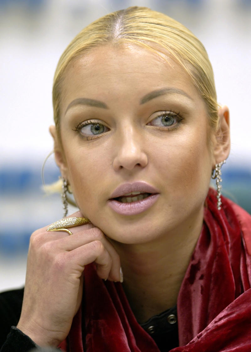 FILE - In this file photo taken on Monday, Dec. 1, 2003, Russian Ballerina Anastasia Volochkova speaks at a news conference in Moscow, Russia. Perhaps the most serious blow so far came from the Kremlin-controlled NTV television broadcasting nationwide, where Tsiskaridze and former Bolshoi premier Anastasia Volochkova accused Iksanov of botching the Bolshoi's reconstruction effort, ruining its repertoire and treating the dancers like slaves. Volochkova even alleged that Iksanov oversaw a practice of ballerinas being used as pleasure escorts for members of the Bolshoi governing board and other powerful figures on management's orders. She didn't name any names. (AP Photo/Alexander Zemlianichenko, File)