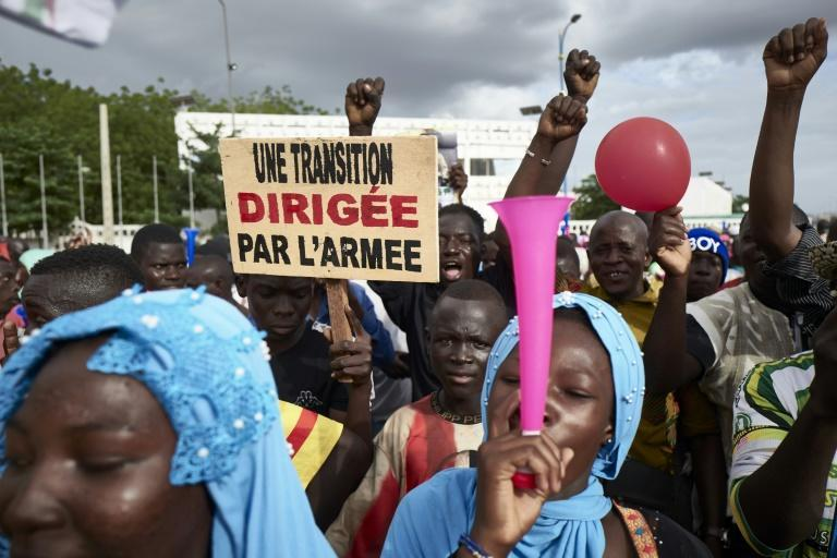 Supporters of Mali's military coup, pictured in Bamako in September. The sign reads: 'A transition led by the army.' But today, discontent about the pace of reform is growing