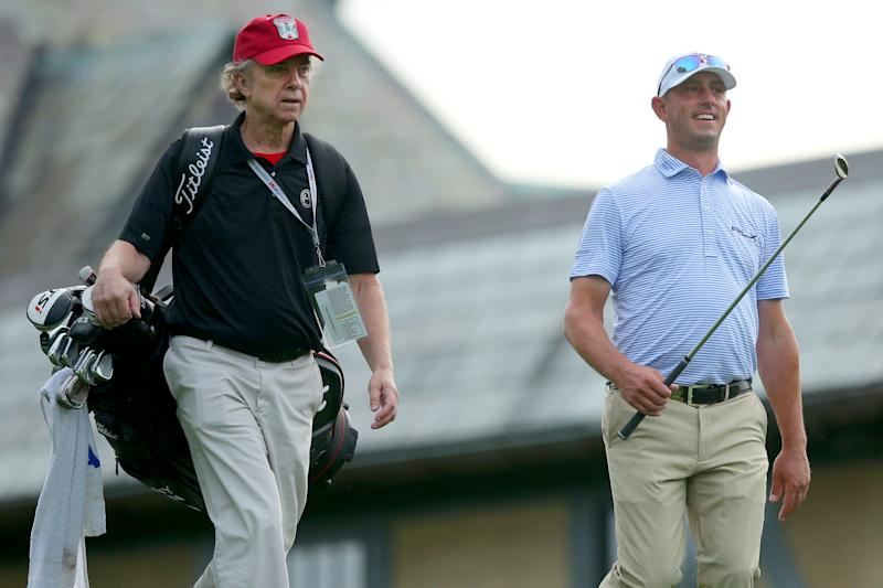 """""""Caddyshack"""" actor Michael O'keefe caddies for golf pro Danny Balin during a U.S. Open practice round on Monday."""