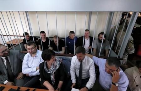Crew members of Ukrainian naval ships, which were seized by Russia's FSB security service in November 2018, attend a court hearing in Moscow
