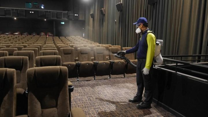 An Express Pest Solutions technician conducts Indoor ULV Misting in a cinema hall at GV Bishan