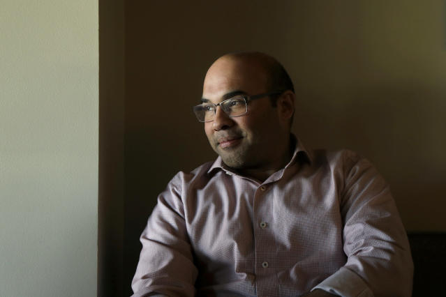 Farhan Zaidi, the San Francisco Giants' president of baseball operations, speaks to reporters at Oracle Park in San Francisco, Thursday, Feb. 6, 2020. (AP Photo/Jeff Chiu)
