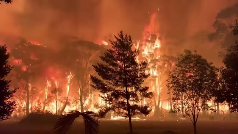 A fire blazes across bush as seen from Mount Tomah in New South Wales, Australia December 15, 2019 in this still image obtained from social media video. NSW RFS (Photo: TERRY HILLS BRIGADE via REUTERS)