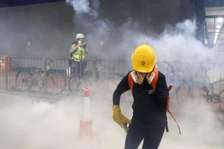 An anti-extradition bill protester reacts after tear gas was fire by the police during a demonstration in Tai Wai in Hong Kong