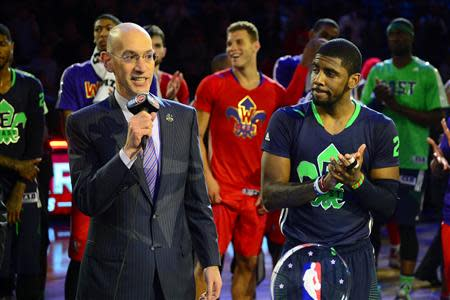 Feb 16, 2014; New Orleans, LA, USA; NBA commissioner Adam Silver speaks while game MVP Eastern Conference Kyrie Irving guard (2) of the Cleveland Cavaliers looks after the 2014 NBA All-Star Game at the Smoothie King Center. Mandatory Credit: Bob Donnan-USA TODAY Sports