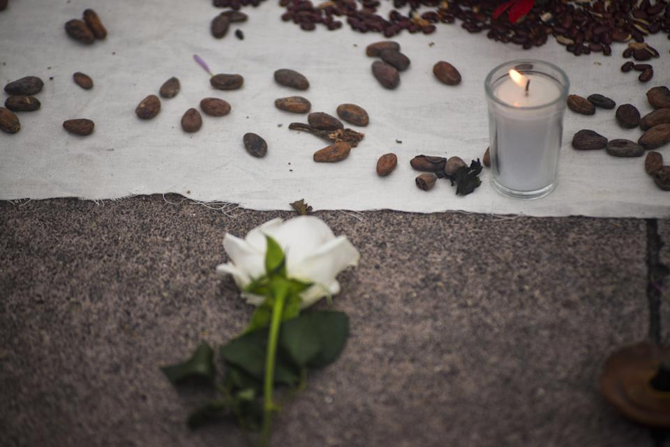 SAN SALVADOR, EL SALVADOR - JULY 04: View of a shrine made up of flowers and candles during a protest against femicide and gender-based violence at Plaza Salvador del Mundo on July 4, 2021 in San Salvador, El Salvador. (Photo by APHOTOGRAFIA/Getty Images)