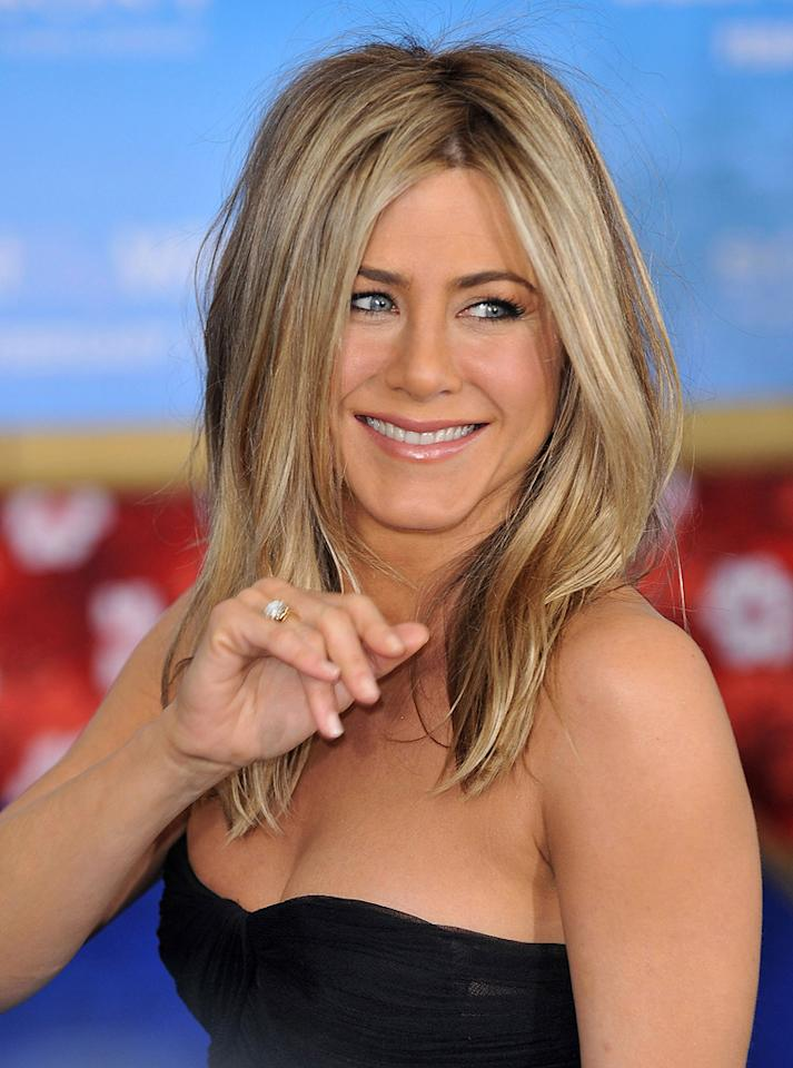 "<i>In Touch</i> reports on its cover that Jennifer Aniston is ""in love"" with Bradley Cooper. The magazine reveals that Aniston is ""throwing herself into this relationship"" because she truly ""sees a future with him."" She even spent most of last weekend while they were apart sending Cooper ""steamy"" texts and e-mails. For how serious they've become, and when they'll finally go public with their romance, click over to <a href=""http://www.gossipcop.com/jennifer-aniston-texting-bradley-cooper/"" target=""new"">Gossip Cop</a>. James Devaney/<a href=""http://www.wireimage.com"" target=""new"">WireImage.com</a> - February 8, 2011"