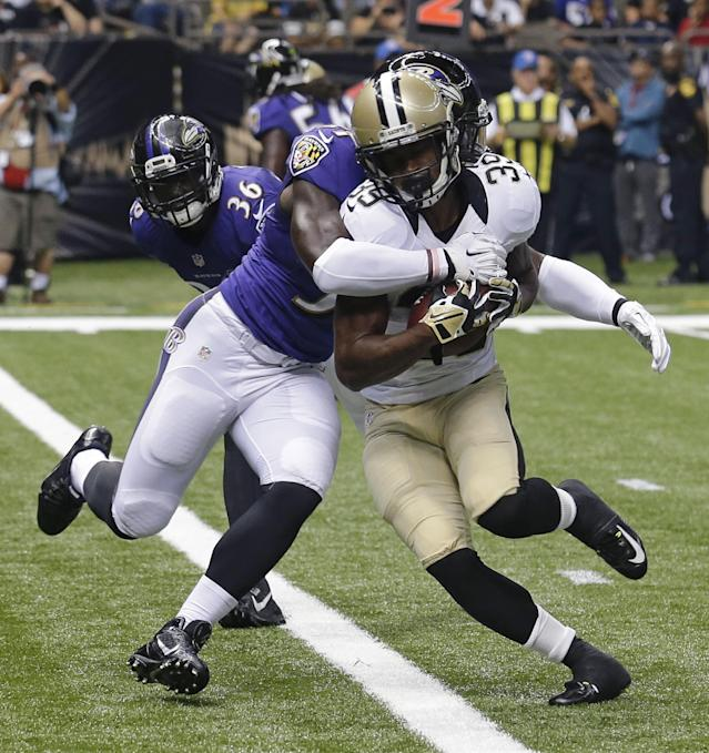 New Orleans Saints running back Travaris Cadet (39) scores a tocuhdown as Baltimore Ravens inside linebacker C.J. Mosley tries to tackle during the first half of an NFL preseason football game in New Orleans, Thursday, Aug. 28, 2014. (AP Photo/Bill Haber)