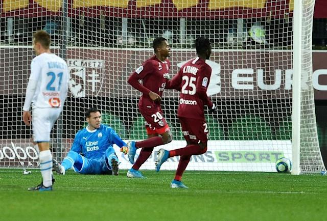 Opa Nguette (L) scored his fourth Ligue 1 goal of the season for Metz (AFP Photo/JEAN-CHRISTOPHE VERHAEGEN)