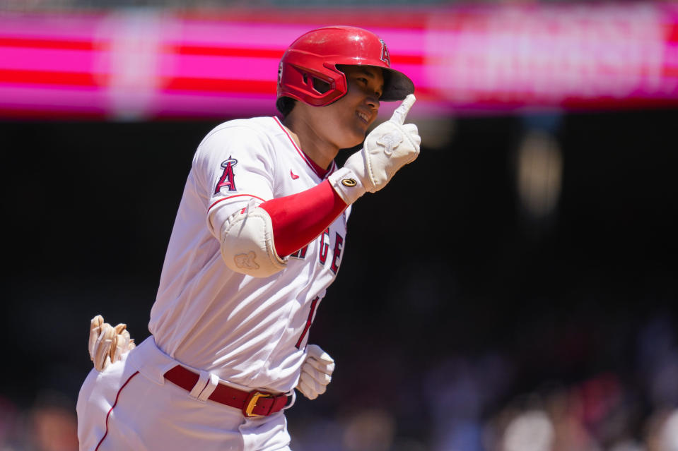 Los Angeles Angels designated hitter Shohei Ohtani (17) runs the bases after hitting a home run during the third inning of a baseball game against the Baltimore Orioles Sunday, July 4, 2021, in Anaheim, Calif. (AP Photo/Ashley Landis)
