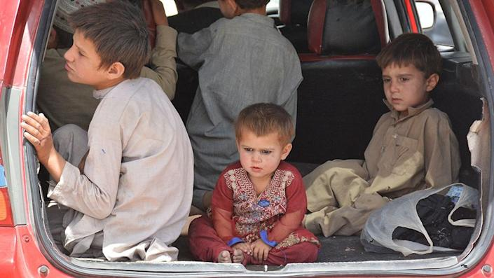 Afghan people wait to enter Pakistan through the Chaman-Spin Boldak border crossing in Afghanistan - 28 August 2021