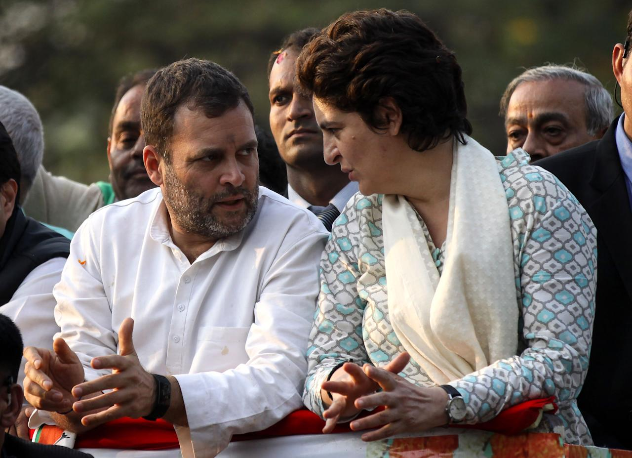 <p>Indian Congress Party leader Rahul Gandhi (L) waves at a political rally next to his sister Priyanka Gandhi Vadra (R) in Lucknow, the capital of the election bellwether Uttar Pradesh state, on February 11, 2019. – India's charismatic opposition leader Priyanka Gandhi Vadra held her first public rally February 11, setting the stage for a keen contest with Prime Minister Narendra Modi in an upcoming general election. (Photo by STR / AFP) (Photo credit should read STR/AFP/Getty Images) </p>