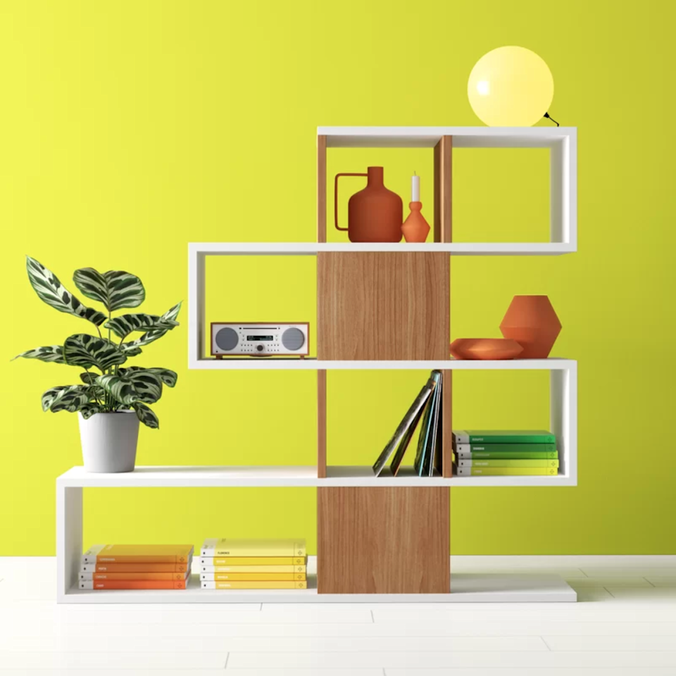 "<h3><a href=""https://www.wayfair.com/furniture/pdp/hashtag-home-dakota-geometric-bookcase-w001787825.html"" rel=""nofollow noopener"" target=""_blank"" data-ylk=""slk:Hashtag Home Dakota Geometric Bookcase"" class=""link rapid-noclick-resp"">Hashtag Home Dakota Geometric Bookcase</a></h3><br><strong>When your apartment is your bedroom (and vice versa)</strong>: When small spaces don't leave room for walls, create your own boundaries by sectioning off the room with a sturdy bookcase unit that offers stylish geometric separation. <br><br><strong>Hashtag Home</strong> Dakota Geometric Bookcase, $, available at <a href=""https://go.skimresources.com/?id=30283X879131&url=https%3A%2F%2Fwww.wayfair.com%2Ffurniture%2Fpdp%2Fhashtag-home-dakota-geometric-bookcase-w001787825.html"" rel=""nofollow noopener"" target=""_blank"" data-ylk=""slk:Wayfair"" class=""link rapid-noclick-resp"">Wayfair</a>"