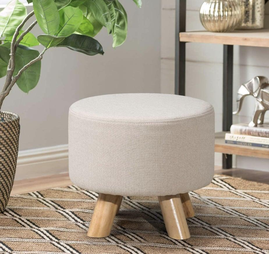 <p>Small and simple, this <span>Asense Round Ottoman</span> ($40) pairs well with other furniture.</p>