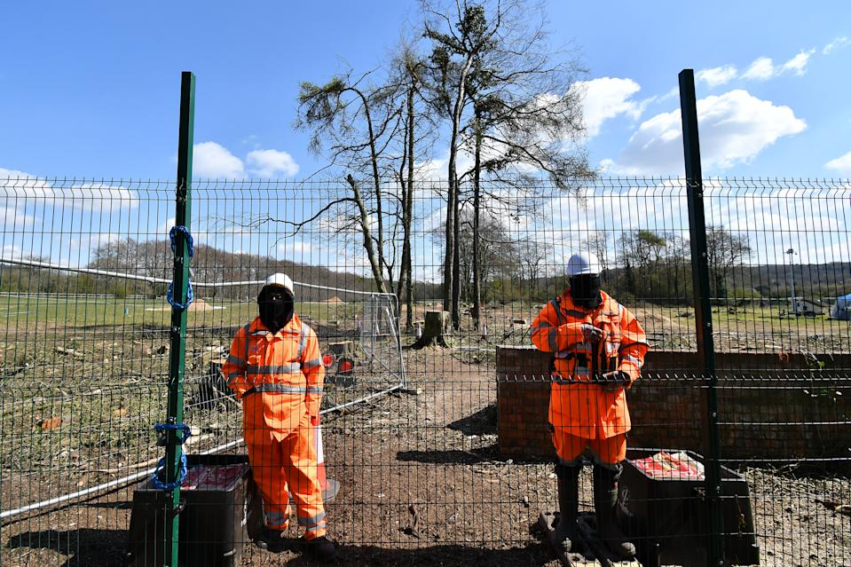 WENDOVER, ENGLAND - APRIL 14:  Security personnel guard an area of felled trees as HS2 works continue on April 14, 2021 in Wendover, England. HS2 protesters continue to occupy key infrastructure sites along the proposed HS2 route calling the project 'the most carbon-intensive and environmentally destructive project in UK history.' (Photo by Jim Dyson/Getty Images)