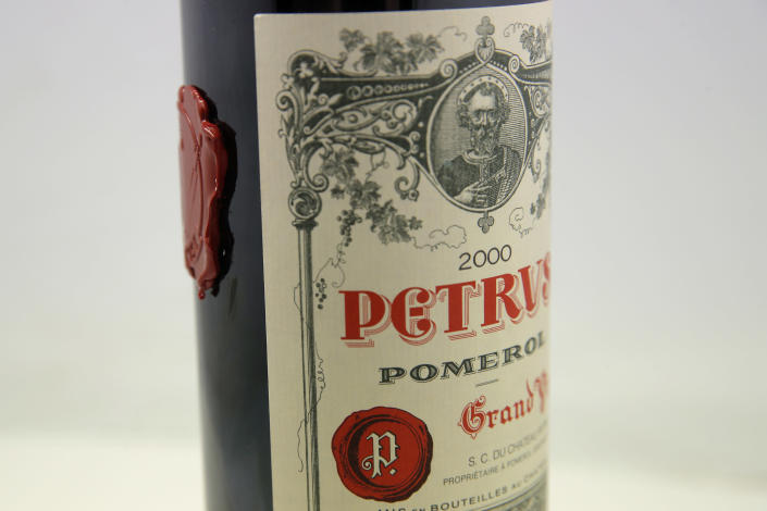 A bottle of Petrus red wine that spent a year orbiting the world in the International Space Station is pictured in Paris Monday, May 3, 2021. The bottle of French wine is up for a private sale at Christie's, with a stratospheric price tag in the region of euro 1 million. (AP Photo/Christophe Ena)