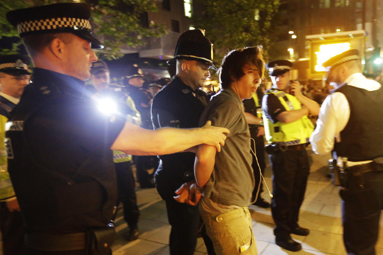 Officers arrests a cyclist after a Critical Mass bike protest outside the Olympic Park during the 2012 Summer Olympics Opening Ceremony, Friday, July 27, 2012, in London. (AP Photo/Matt Rourke)