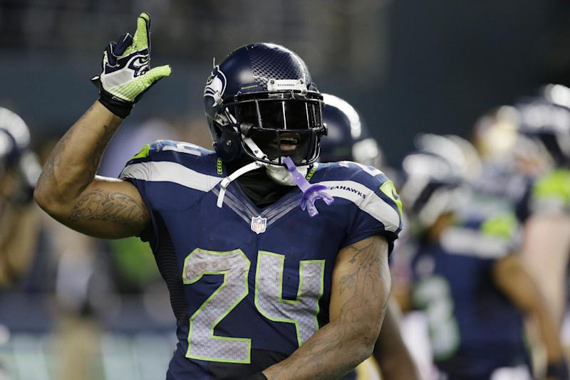 Seattle Seahawks' Marshawn Lynch celebrates a touchdown against the San Francisco 49ers in the second half of an NFL football game, Sunday, Sept. 15, 2013, in Seattle. The Seahawks beat the 49ers 29-3. (AP Photo/Elaine Thompson)