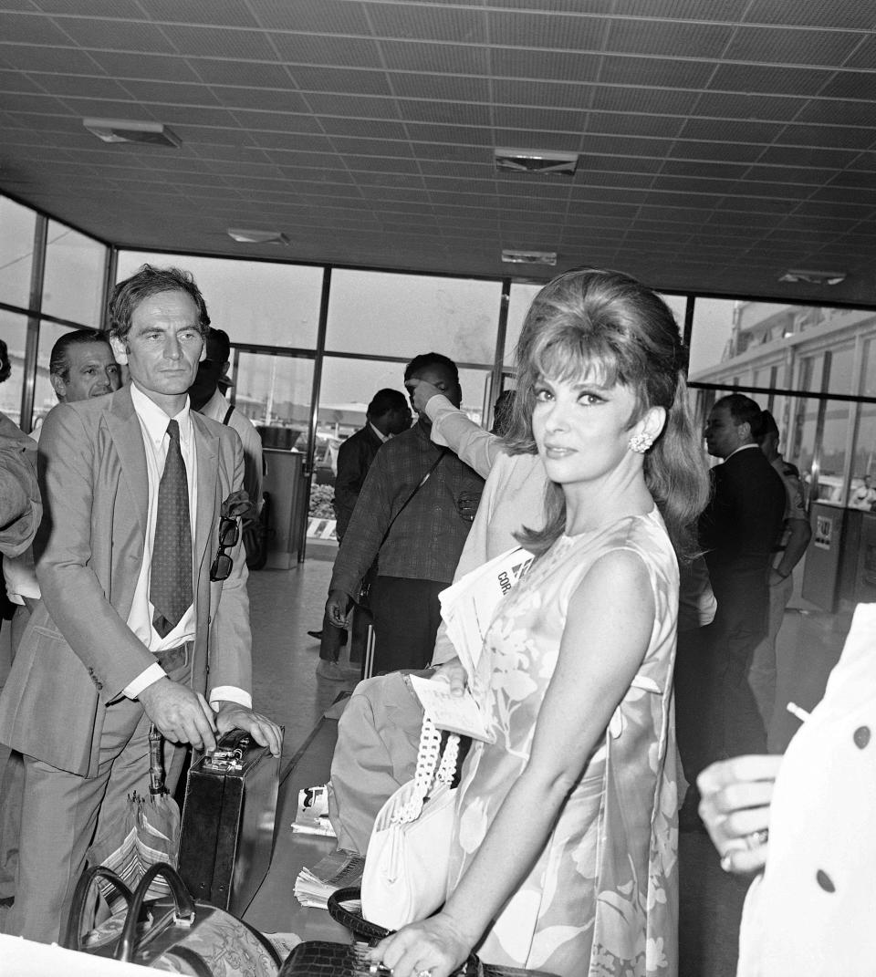 FILE - In this Sept.7, 1967 file photo, Italy's Gina Lollobrigida and French designer Pierre Cardin arrive at the Venice airport to attend the Venice International Film Festival. France's Academy of Fine Arts says famed fashion designer Pierre Cardin has died at 98 (AP Photo, File)