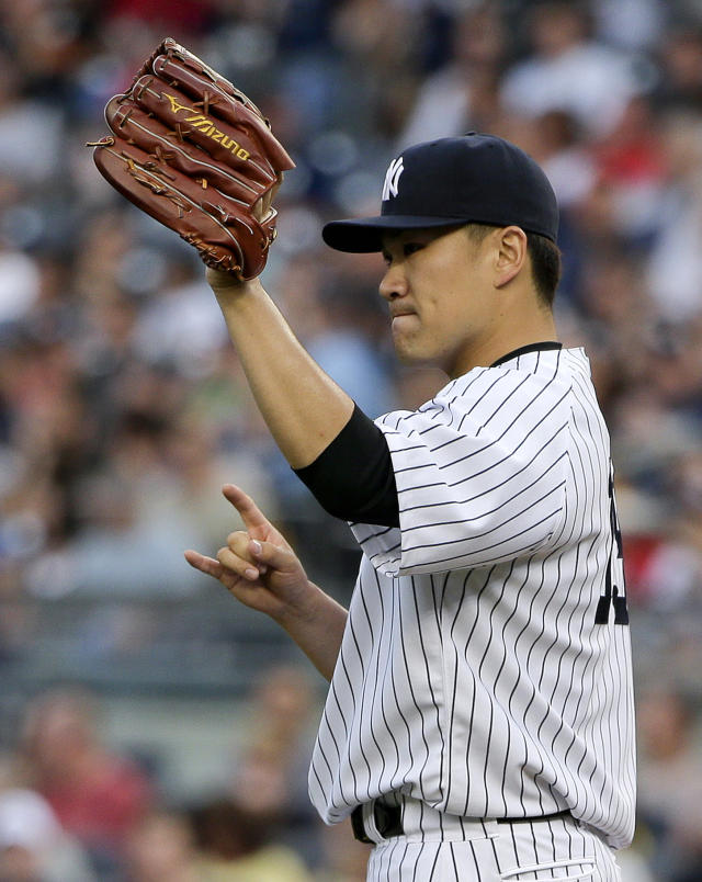 New York Yankees pitcher Masahiro Tanaka motions to teammates after an out against the Boston Red Sox in the first inning of a baseball game, Saturday, June 28, 2014, in New York. (AP Photo/Julie Jacobson)