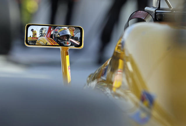 Driver Ryan Hunter-Reay waits in his car before a practice session for the IndyCar Grand Prix auto race at Indianapolis Motor Speedway, in Indianapolis Friday, May 11, 2018. (AP Photo/Darron Cummings)