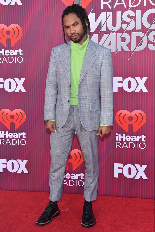 <p>WHAT: Calvin Klein 205W39NYC</p> <p>WHERE: The iHeart Radio Music Awards in Los Angeles</p> <p>WHEN: March 14, 2019</p> <p>WHY: With a neon turtleneck and some crafty tailoring, Miguel makes the gray suit look positively wild.</p>