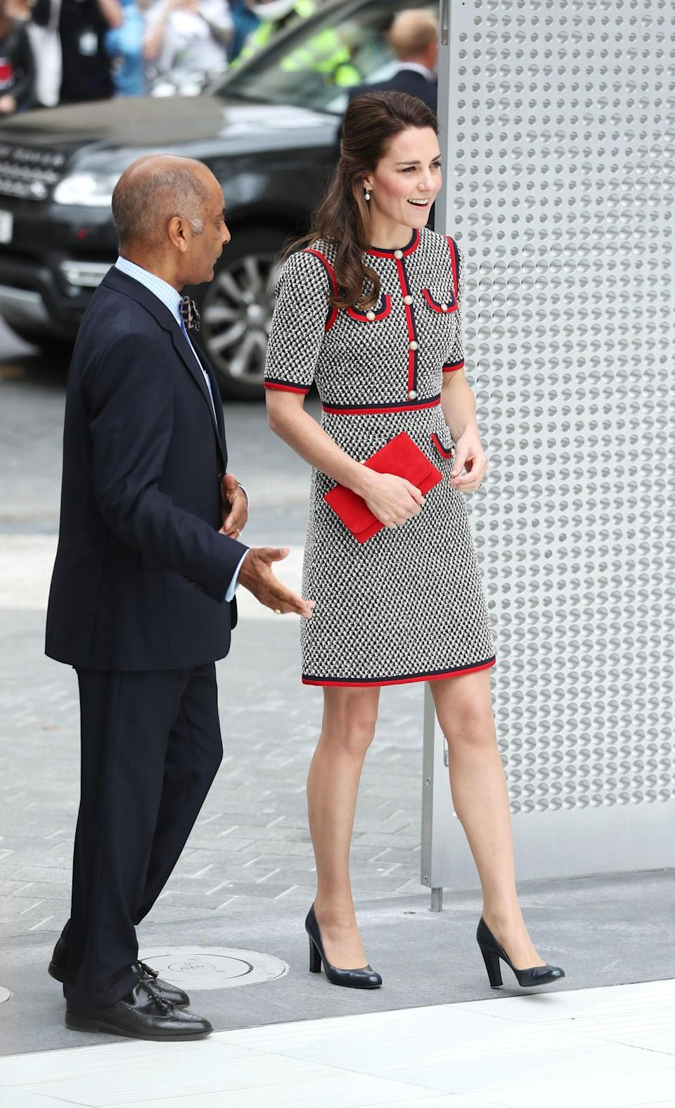 <p>Kate ditched her usual skirt suits for an appearance at London's V&A museum. Instead, she wore a monochrome tweed dress by Gucci; the first time the Duchess has ever been seen in anything by the Italian brand.<br><i>[Photo: PA]</i> </p>