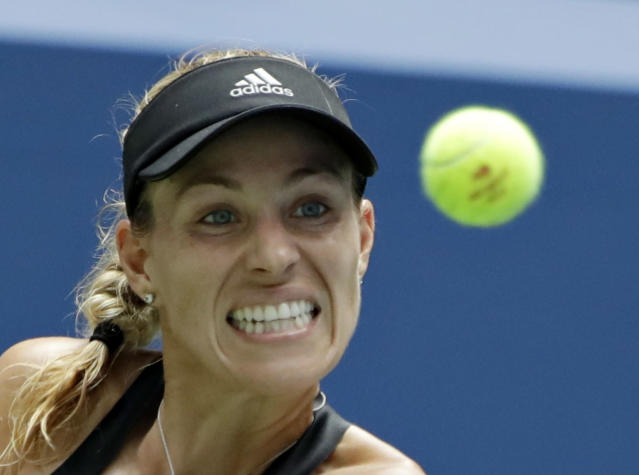 Angelique Kerber, of Germany, returns a shot to Johanna Larsson, of Sweden, during the second round of the U.S. Open tennis tournament, Thursday, Aug. 30, 2018, in New York. (AP Photo/Kevin Hagen)