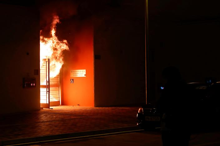 Anti-government protesters in Hong Kong set alight the lobby of a newly built residential building that authorities were planning to use as a quarantine facility for coronavirus sufferers. (Reuters)
