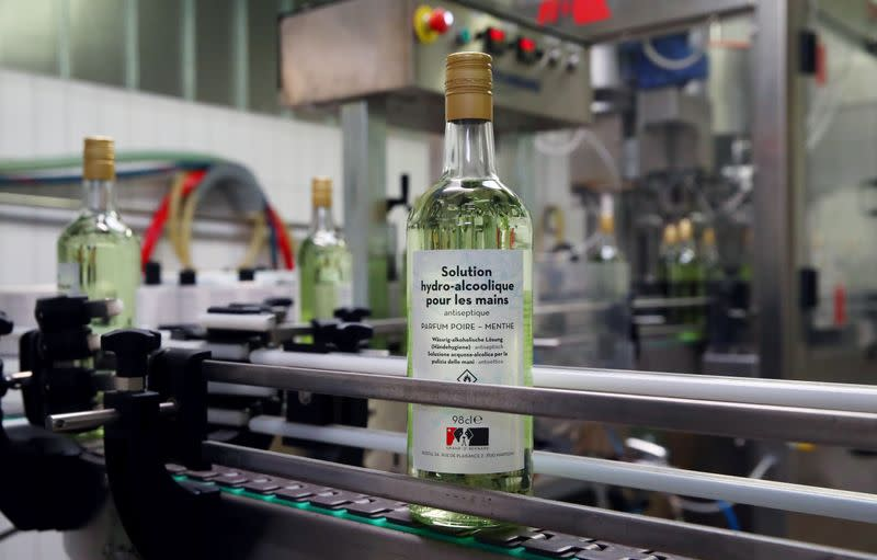 A bottle of pear and mint alcohol is pictured at Swiss distiller Morand in Martigny