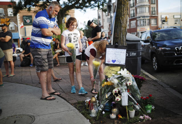 <p>People add flowers and messages to a memorial remembering the victims of Sunday's shooting in Toronto on Monday, July 23, 2018. (Photo: Mark Blinch/The Canadian Press via AP) </p>