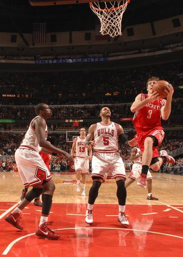 CHICAGO, IL - APRIL 02: Goran Dragic #3 of the Houston Rockets goes to the basket past Carlos Boozer #5 and Luol Deng #9 of the Chicago Bulls during the NBA game on April 2, 2012 at the United Center in Chicago, Illinois. (Photo by Ray Amati/NBAE via Getty Images)