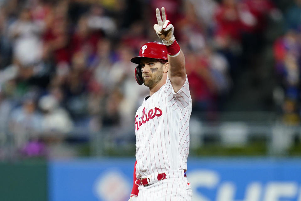 Philadelphia Phillies' Bryce Harper reacts after hitting an RBI-double off Pittsburgh Pirates' Miguel Yajure during the fifth inning of a baseball game, Friday, Sept. 24, 2021, in Philadelphia. (AP Photo/Matt Slocum)