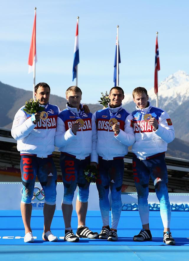 SOCHI, RUSSIA - FEBRUARY 23: Gold medalists Russia team 1 celebrate on the podium during the medal ceremony for the Four-Man Bobsleigh on Day 16 of the Sochi 2014 Winter Olympics at Sliding Center Sanki on February 23, 2014 in Sochi, Russia. (Photo by Cameron Spencer/Getty Images)