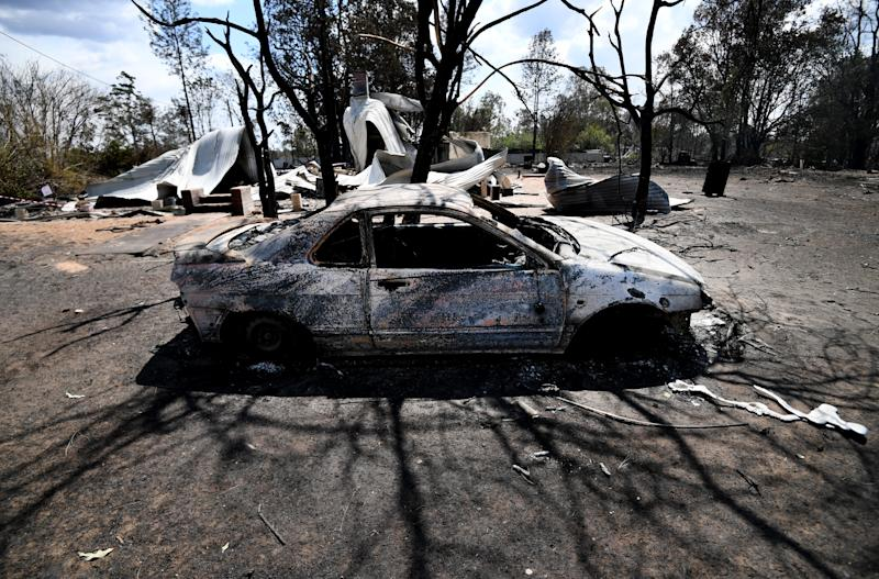 Picture of a car burnt by the bushfire in the rural town of Rappville.
