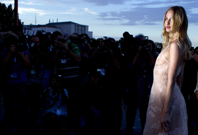 Actress Eva Riccobono, who will host the 70th edition of the Venice Film Festival, poses for photographers during a photo call in Venice, Italy, Tuesday, Aug. 27, 2013. (AP Photo/Andrew Medichini)