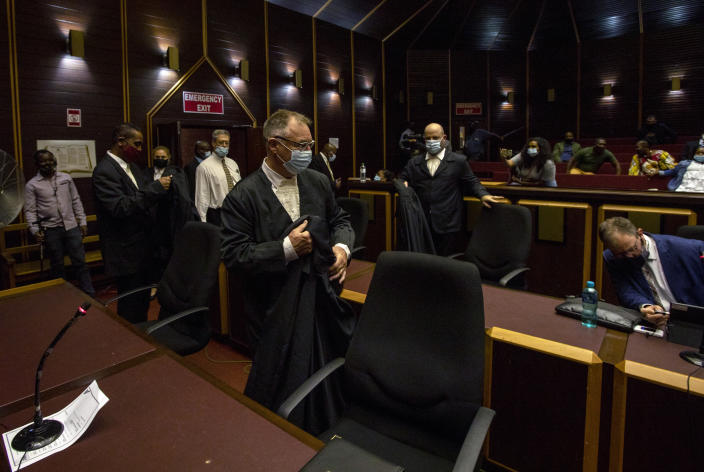 Legal teams arrive at the High Court in Pietermaritzburg, South Africa, Tuesday, Feb. 23, 2021. A South African judge said he will file a criminal complaint against former South African president Jacob Zuma after he staged a dramatic walkout while attending a commission of inquiry looking into corruption during his tenure from 2009 to 2018. (AP Photo/Themba Hadebe)