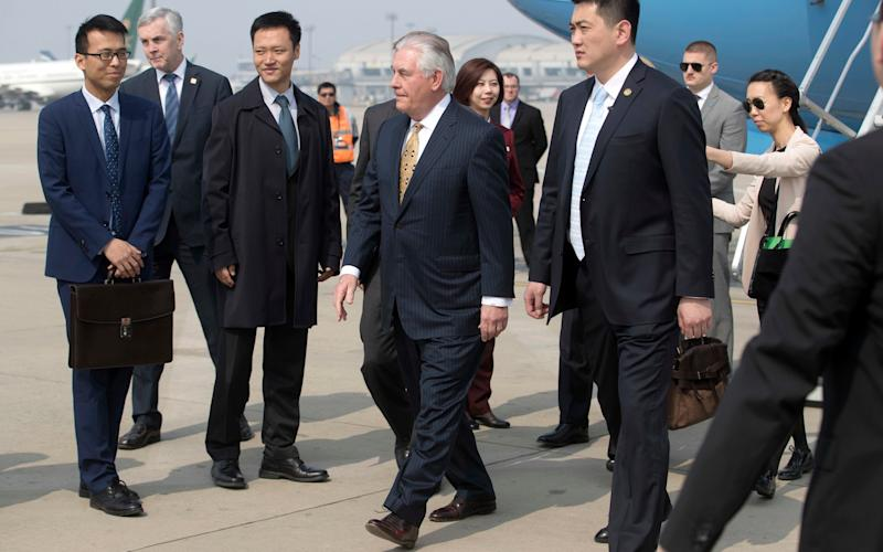 U.S. Secretary of State Rex Tillerson, center, arrives at Beijing Capital International Airport in Beijing, China, Saturday, March 18, 2017. - Mark Schiefelbein/AP Photo