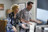 """This image released by ABC shows Julie Bowen, left, and Ty Burrell in a scene from the series finale of """"Modern Family."""" The popular comedy series ends its 11-season run with a two-hour finale on Wednesday. (Bonnie Osborne/ABC via AP)"""