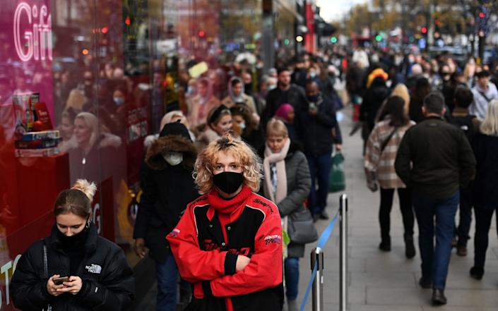 Shoppers on Oxford Street during the first weekend after lockdown in London - Andy Rain/EPA-EFE/Shutterstock