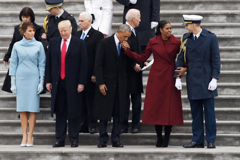Mr Trump at his inauguration alongside outgoing president Barack Obama and vice president Joe Biden (AFP via Getty Images)