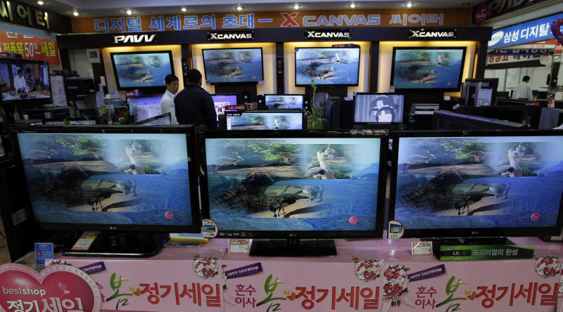 South Korean customers look at the LG electronics' TV products which made with LG Display panels at a Yongsan Electronic shop in Seoul, South Korea, Tuesday, April 24, 2012. LG Display Co., the world's second-largest maker of liquid crystal displays, Tuesday reported its third straight quarterly loss due to feeble demand for TVs. (AP Photo/Lee Jin-man)