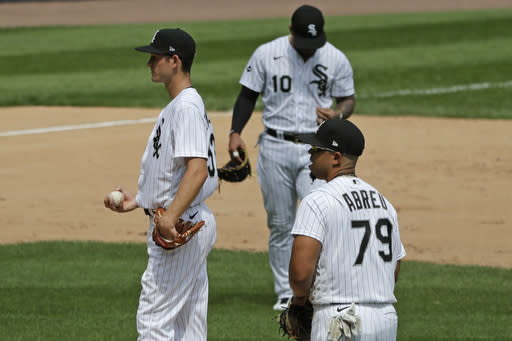 Chicago White Sox relief pitcher Drew Anderson, left, third baseman Yoan Moncada, center, and first baseman Jose Abreu, right, wait for manager Rick Renteria after Cleveland Indians' Jordan Luplow hit a two-run home run during the fourth inning of a baseball game in Chicago, Saturday, Aug. 8, 2020. (AP Photo/Nam Y. Huh)