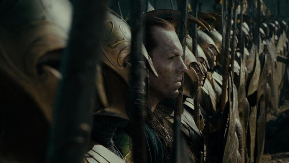 Elrond stands among an army of Elves in the War of the Last Alliance from the prologue to The Fellowship of the Ring.
