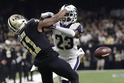 FILE - In this Jan. 20, 2019, file photo, Los Angeles Rams' Nickell Robey-Coleman breaks up a pass intended for New Orleans Saints' Tommylee Lewis during the second half of the NFL football NFC championship game in New Orleans. Remember back to the NFC championship game in the 2018 season. Deep in the fourth quarter at the Superdome. And the missed call one of the worst officiating gaffes in pro football memory. What the NFL came up with was a one-year trial in which pass interference calls could be reviewed in the video replay system, it was hailed as major step to aid officiating. But the NFL blew it, and on Thursday, May 28, 2020, barring a stunning turnaround, the rule will disappear. (AP Photo/Gerald Herbert, File)