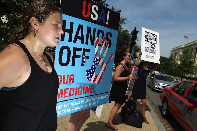 Demonstrators protest in Washington against the Trans-Pacific Partnership trade pact, which critics fear could lead to higher costs for generic drugs, longer copyright protections and a more tightly-regulated Internet